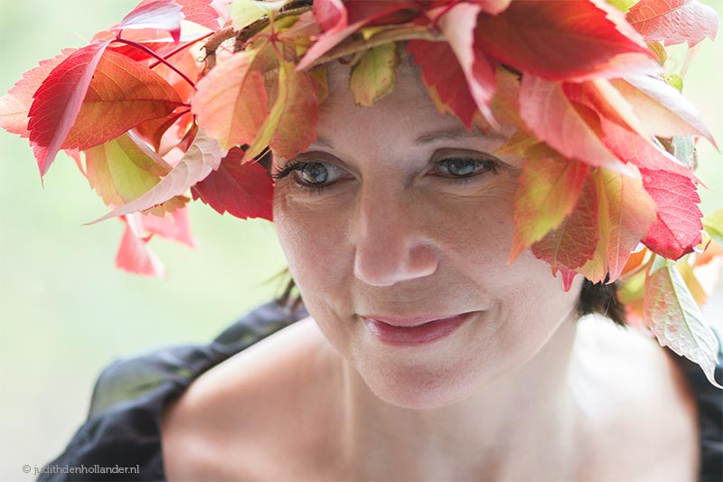 Woman with a head piece that is made from autumn (indian summer colours) leaves.