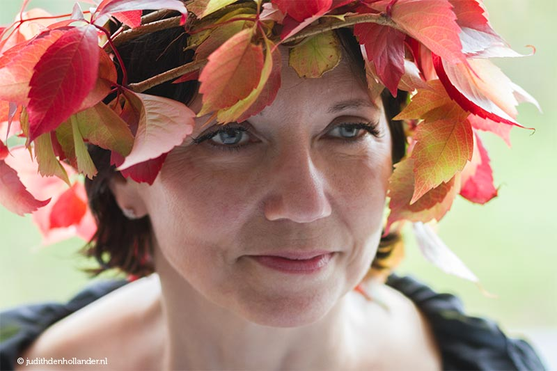 Head shot | Indian summer colours inspiration - woman wearing autumn leaves head piece.